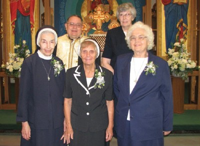 Sister Euphemia Kopa, Sister Jean Marie Cihota, Sister Margaret Fedyszak are pictured with Monastery Chaplain Father Michael Huszti and Sisters of St. Basil the Great Provincial Sister Ruth Plante.